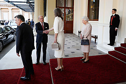 Queen Elizabeth II (second right) and the Duke of Edinburgh (second left) bid farewell to Colombia's President Juan Manuel Santos and his wife Maria Clemencia de Santos at Buckingham Palace in London.