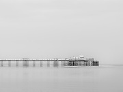 Editions of 8<br /> B&W version of a very monochromatic day in Llandudno Wales along the coastline with the Victorian Pier