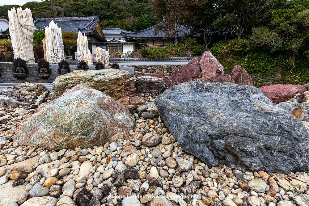 Temple 38 Kongofuku-ji - Stone garden rockery at Kongofuku-ji -  The overlooks Cape Ashizuri and the Pacific Ocean at the tip of the Ashizuri Peninsula, it has always enjoyed the patronage of aristocrats, warriors, and noble clans like the Minamoto, Chosokabe, and Yamanouchi. Consequently it survived intact through the early Meiji years when other temples suffered damage. The temple stands in a garden of colourful stones, which are reflected in a large pond. There are numerous pines, and the hill behind the temple is cloaked in windswept trees.Cape Ashizuri is the southernmost point of Shikoku, infamous throughout Japan for its fierce and changeable weather. Kogofukuji is also one of the most dramatic and picturesque of all the 88 temples, thanks to its remote location overlooking Cape Ashizuri.