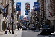 As some non-essential shops re-open, shoppers return to Bond Street while social distancing measures are put in place by the various retail shops which are open on 26th June 2020 in London, England, United Kingdom. As the July deadline approaces and government will relax its lockdown rules further, the West End remains quiet, apart from this popular shopping district, which itself has far fewer people on its pavements than normal.