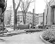 Y-590413-01.  Removal of War Memorial board on South Park Blocks, on SW Jefferson, looking SW. In the background, from left to right, Jeanne Manor apartments, Cumberland apartments, 6th Church of Christ Scientist. April 13, 1959