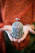 A woman holds a jewellery box encrusted with precious stones at the Gem Palace, Jaipur's foremost jewellers, Jaipur, India
