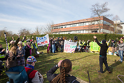Windsor, UK. 22nd February, 2019. Hamish Haynes of the Preston New Road campaign urges around 60 campaigners from Reclaim the Power and Fuel Poverty Action to wave to Centrica employees during a family-friendly protest outside the headquarters of Centrica to call on the British multinational energy and services company to cease its support for fracking operations through its partnership with shale gas company Cuadrilla Resources.