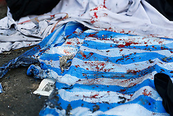 © Licensed to London News Pictures. 19/01/2014. Blood covers a sheet used to cover the floor used by a street side vendor as a result of a grenade attack.The grenade attack has reportedly injured 28 people at the protest site at the Victory Monument in Bangkok Thailand. Anti-government protesters launch 'Bangkok Shutdown', blocking major intersections in the heart of the capital, as part of their bid to oust the government of Prime Minister Yingluck Shinawatra ahead of elections scheduled to take place on February 2. Photo credit : Asanka Brendon Ratnayake/LNP