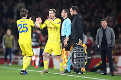 FC BATE Borisov's Aleksandr Hleb (centre) comes on for substituted Dzmitry Baha (left) during the UEFA Europa League round of 32 second leg match at the Emirates Stadium, London.