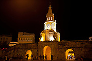 Clock tower at night street scene, Cartagena historic old city UNESCO World heritage site, capital of Bolivar department, Colombia.