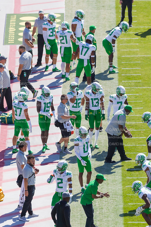 PALO ALTO, CA - OCTOBER 2:  The Oregon Ducks football team warms up before before a Pac-12 football game against the Stanford Cardinal on October 2, 2021 at Stanford Stadium in Palo Alto, California.  (Photo by David Madison/Getty Images)