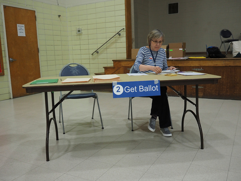 Poll worker at Get Ballot station finalizes paperwork as polls close on Election Day, November 5, 2019