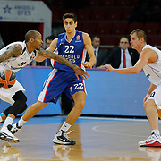 Anadolu Efes's Furkan Korkmaz (C) and Nizhny Novgorod's Tarence Kinsey (L) during their Turkish Airlines Euroleague Basketball Group A Round 9 match Anadolu Efes between Nizhny Novgorod at Abdi ipekci arena in Istanbul, Turkey, Friday December 12, 2014. Photo by Aykut AKICI/TURKPIX