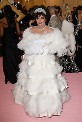 Joan Collins attending the Costume Institute Benefit at The Metropolitan Museum of Art celebrating the opening of Heavenly Bodies: Fashion and the Catholic Imagination. The Metropolitan Museum of Art, New York City, New York, May 6, 2019.