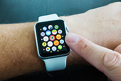 Detail of home screen with app icons of Apple watch with white strap