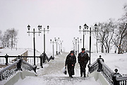 Khabarovsk, Russia, 28/02/2004.&#xD;An old couple climb steps from the banks of the frozen Amur river to the city centre.&#xD;<br />