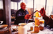 A Tbilisi market vendor gives samples of his honey in Tbilisi, Soviet Georgia - 1990