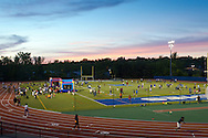 """Middletown, New York - Children play games with Middletown High School athletes at Faller Field during Family Fun Night on May 17, 2013. After dark """"The Lorax"""" was shown on the stadium screen."""
