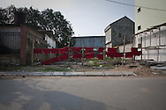 Burgundy red cloths are hanged to dry on a small lane in Vinh, Vietnam, Asia