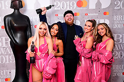 Leigh-Anne Pinnock, Jesy Nelson, Perrie Edwards and Jade Thirlwall of Little Mix with their Best British Video Brit Award and Tom Wallker with his Best British Breakthrough Act Brit Award in the press room at the Brit Awards 2019 at the O2 Arena, London.