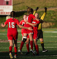 Katie Gagnon gives Kelsey Scott a hug after scoring Belmont's first goal in the semi final girls soccer at Laconia High School Tuesday afternoon.   (Karen Bobotas/for the Laconia Daily Sun)