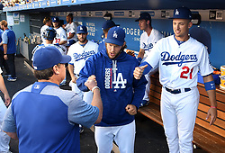 June 27, 2017 - Los Angeles, California, U.S. - Los Angeles Dodgers pitching coach Rick Honeycutt fist pumps Clayton Kershaw,center, and Trayce Thompson (21) prior to a Major League baseball game between the Los Angeles Angels and the Los Angeles Dodgers at Dodger Stadium on Tuesday, June 27, 2017 in Los Angeles. (Photo by Keith Birmingham, Pasadena Star-News/SCNG) (Credit Image: © San Gabriel Valley Tribune via ZUMA Wire)