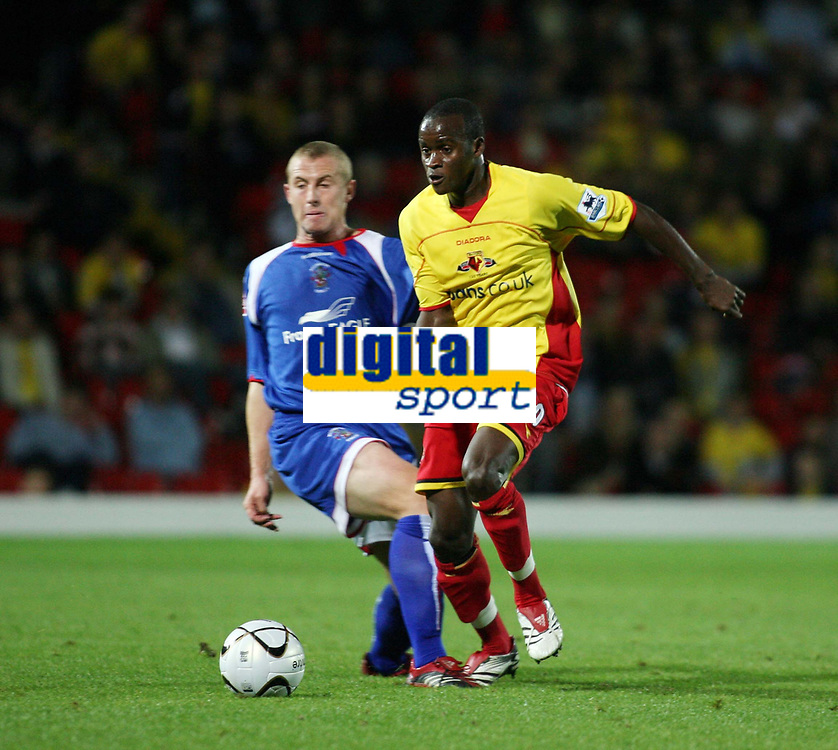 Photo: Chris Ratcliffe.<br />Watford v Accrington Stanley. Carling Cup. 19/09/2006.<br />Ai Bangura (R) of Watford clashes with Philip Edwards of Accrington Stanley.