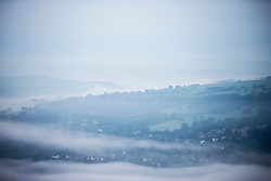 © Licensed to London News Pictures. 13/09/2016. Ilkley UK. Picture shows low lying fog at dawn this morning over the town of Ilkey on what is predicted to be the hottest day in September. Photo credit: Andrew McCaren/LNP