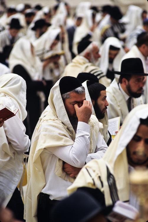 Men praying at the Western Wall.