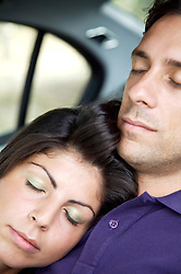 Close up of young couple sleeping