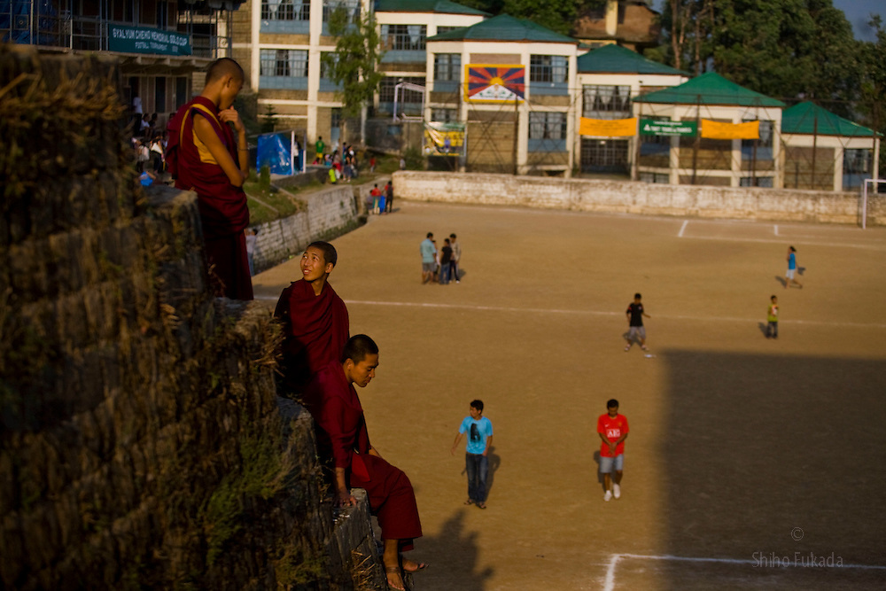 Monks leave Tibetan soccer match in McLeod Ganj, Dharamsala, India, where the Dalai Lama settled after fleeing Tibet in 1959 after a failed uprising against Chinese rule, June 1, 2009.