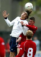 Fotball<br /> Photo: Richard Lane, Digitalsport.<br /> Wales v Norge U19 Friendly International at Bethesda. 11/05/2004.<br /> Petter Hansen - FK Tønsberg - beats Michell Booth to the ball.