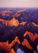Aerial view of sunrise light illuminating granite spires of the Tombstone Range above Grizzly and Twin Lakes, Tombstone Territiorial Park, Yukon Territory, Canada.