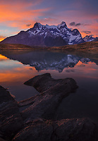 Paine Grande sunset reflects in the calm waters of Lago Nordenerskjold, Torres del Paine National Park, Patagonia, Chile