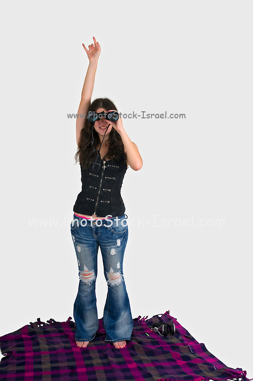 Young female spectator enjoys the music at a music festival on white background