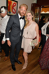 ALISTAIR GUY and A E O'NEILL at the 50th anniversary party for Daphne's restaurant, 112 Draycott Avenue, London held on 24th June 2014.