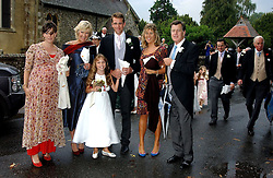 Left to right, ALICE ELLIOT, ANNABEL ELLIOT, BEN ELLIOT, KATE ELLIOT, SIMON ELLIOT and in front Mark Shand's daughter AYESHA at the wedding of Tom Parker Bowles to Sara Buys at St.Nicholas Church, Rotherfield Greys, Oxfordshire on 10th September 2005.<br />