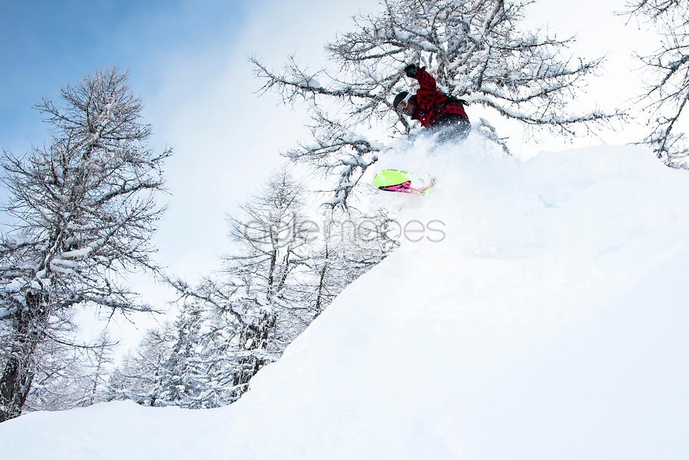 Snowboarder Jumping Stunt in Powder Snow