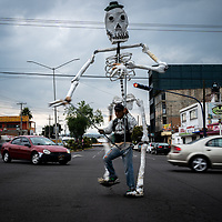 A skeleton dancer at the traffic lights, Apizaco, Mexico.