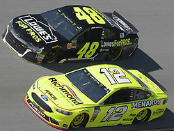 April 29, 2018 - Talladega, AL, U.S. - TALLADEGA, AL - APRIL 29: Ryan Blaney, Team Penske, Ford Fusion Menards/Richmond (12) and Jimmie Johnson, Hendrick Motorsports, Chevrolet Camaro Lowe's for Pros (48) race side by side during the Monster Energy Cup Series 49th Annual Geico 500 on April 29, 2018, at Talladega Superspeedway in Talladega, AL. (Photo by Jeffrey Vest/Icon Sportswire) (Credit Image: © Jeffrey Vest/Icon SMI via ZUMA Press)