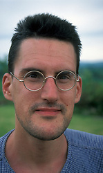 Portrait of man in his early 30s wearing glasses UK. MR