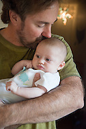 Father Kissing Infant Daughter