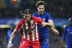 5 December 2017 - Champions League Football - Chelsea v Atletico Madrid - Filipe Luis of Atletico Madrid and Cesc Fabregas of Chelsea battle for the ball - Photo: Charlotte Wilson / Offside