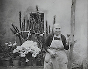 senior woman holding one of her cactus plants France