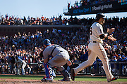 San Francisco Giants left fielder Angel Pagan (16) scores a run against the Los Angeles Dodgers at AT&T Park in San Francisco, Calif., on October 1, 2016. (Stan Olszewski/Special to S.F. Examiner)