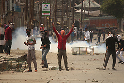May 5, 2018 - Srinagar, Jammu and Kashmir, India - Protesters clash with Indian police in Srinagar the summer of Indian controlled Kashmir on May 05, 2018. Four people including a protester and three rebels were killed during a gun-battle between rebels and Indian forces in Chattabal area of Srinagar. Massive clashes erupt across Srinagar after the news about the trapping of rebels and killing of protester spread across the city. Police fired teargas canisters, pellets, stun grenades and rubber coated bullets to disperse the angry crowd. (Credit Image: © Faisal Khan via ZUMA Wire)