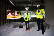 (L to R) Brandon Trippett, 12, and Emmitt Smith speak to the media about the new art room at the Salvation Army renovation project in Arlington on Thursday, March 14, 2013. (Cooper Neill/The Dallas Morning News)