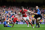 Alex Cuthbert of Wales © bursts through to run in and score the opening goal. RBS Six nations champs 2012, Wales v France at the Millennium Stadium in Cardiff, South Wales on Saturday 17th March 2012.  pic by Andrew Orchard, Andrew Orchard sports photography,