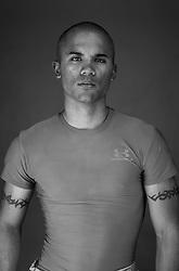 Lcpl. Mark David Ambulo Encarnacion, 20, San Diego, California, 3rd Platoon, Kilo Company, 3rd Battalion, 1st Marine Regiment, 1st Marine Division, United States Marine Corps, at the company's firm base in Hit, Iraq on Friday Sept. 23, 2005.