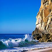 Wave crashing at beach in Cabo San Lucas. Baja California Sur, Mexico.
