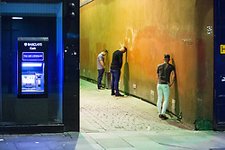 © Licensed to London News Pictures . 11/09/2016 . Manchester , UK . Three men urinate in an alleyway off of Market Street . Revellers out in Manchester City Centre . Photo credit : Joel Goodman/LNP