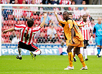 Photo: Daniel Hambury.<br /> Southampton v Wolves. Coca Cola Championship.<br /> 06/08/2005.<br /> Southampton's Dennis Wise falls to the ground after being tackled by Wolves' Rohan Ricketts.