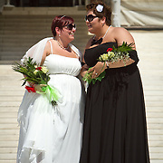 Shannon Glatz, left, and Liberty Manos, of Akron Ohio,descend the steps of the Supreme Court of the United States after baing married with twenty-four other couples, on June 21, 2013.  John Boal photography