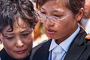 14 SEPTEMBER 2003 - CANCUN, QUINTANA ROO, MEXICO:  Members of Lee Kyung-hae's family mourn during a memorial service for Lee Kyung-hae, the South Korean farmer who committed suicided during a protest against liberalized agricultural trade at the WTO ministerial in Cancun. Tens of thousands of protesters, mostly farmers, came to Cancun for the fifth ministerial of the World Trade Organization (WTO). They were protesting against developed nations pushing to get access to agricultural markets in developing nations. The talks ultimately collapsed after no progress with no agreements reached between the participants.          PHOTO BY JACK KURTZ